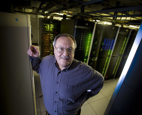 IIHR Research Computing Director Mark Wilson with high-performance computing servers.